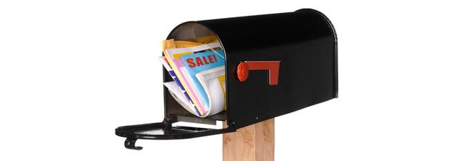 mailbox stuffed full of mail